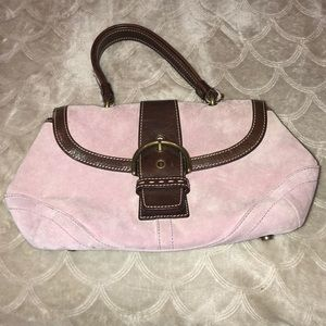 Pink and brown Coach purse.